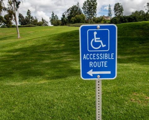 handicap sign indicating accessible route